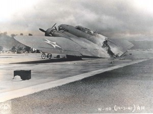 Historic photo of a plane crash on the runway of Hickam Field taken in 1941