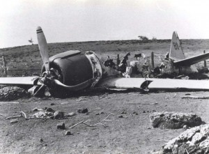 Historic photo of a damaged aircraft on Hickam Field taken in 1941