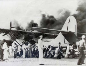 Historic photo of an aircraft engine catching fire on the runway at Kaneohe Naval Air Station