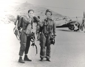 Historic photo  of military servicemen standing with an aircraft in the background
