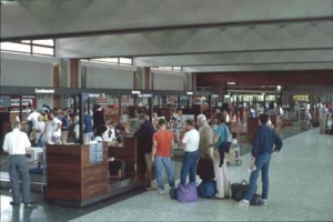 Travelers checking in at the HNL Ticket Lobby