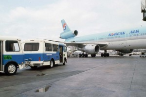 Shuttles arriving at a Korean Air aircraft