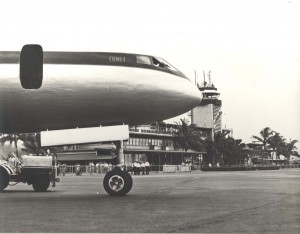 Historic photo of a nose of the aircraft with the HNL tower in the background