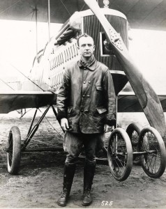 Historical photo of Capt John Curry standing in-front of his airplane