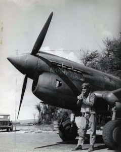 Maj. N. K. Health, CO, by his ship Mammy Yokum at Bellows Field, c1940s.