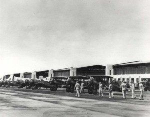 Douglas B-18 Bolo Bombers and Boeing P-26 and P-12E aircraft parked on flight line at Hickam Field, 1940.