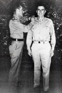 Maj. Gen. Clarence A. Tinker, commanding general of 7th Air Force, pins stars of Brig. Gen. on Col. William Farthing, Commander of the 7th Air Force Base Command, atHickam Field, October 1, 1941.