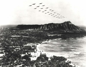 Trick photo; not authentic. Created by combining 1-18-1934 photo of Waikiki and April 6, 1940 photo of B-18 formation over Oahu.