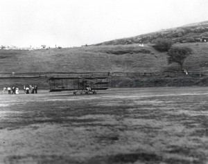 Bud Mars' biplane on the grass at Moanalua Field where approximately 3,000 people witnessed the first flight of a heavier than air machine over Hawaii soil.