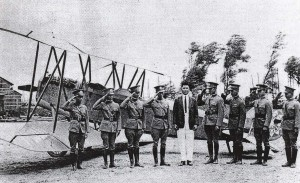 Sun Yet Young was the first Hawaii resident to earn a pilot's license. Here he stands in the midst of Chinese fliers.