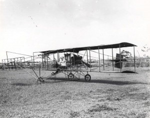 Mason Didier, French Aviator, Poses on his bi-plane before taking off from Leilehua (Schofield Barracks Field) on June 22, 1911. He later crashed.