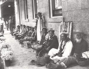 Lei sellers in downtown Honolulu, c1900.