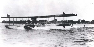 Seaplane tows surfers in Hawaii, c1920.