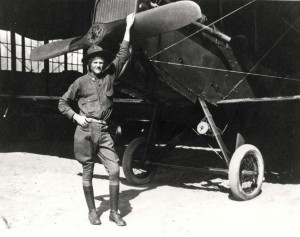 DH-4 Aircraft at Luke Field assigned to 4th or 6th Aero Squadron, c1921-1922. Pvt. Elmer McIntire, 3rd Balloon Company, Ft. Ruger, stands in front.