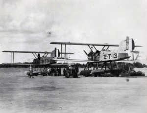 Two Douglas torpedo planes are towed to the water's edge at Pearl Harbor, May 15, 1924.