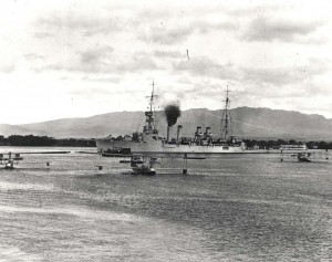Three F5Ls at anchor with USS Omaha and testing torpedo barge in background at Pearl Harbor Fokker harbor, July 1, 1925.