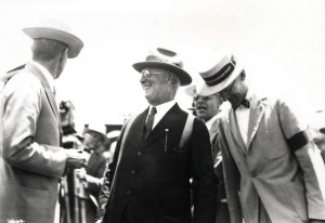 Dole Derby organizer James B. Dole and Clarence Cook watching the landing of Art Goebel's plane at Wheeler Field, August 17, 1927.