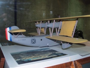 A display with a model of the PN-9 No. 1 is featured in the Central Concourse of Honolulu International Airport. The display recalls the flight of Navy Commander John Rodgers and his crew.