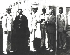 John Rodgers presented a barograph to Governor Farrington to substantiate the official distance record he and his crew achieved, September 10, 1925.