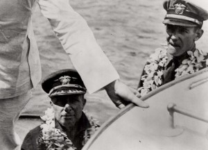 Commander John Rodgers, left, and B. J. Connell, right, are shown leaving Nawiliwili Harbor on Kauai on September 11, 1925 for Pearl Harbor.