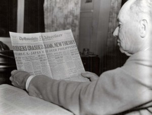 Pilot B. J. Connell reads an article about the plane and crew presumably being lost at sea in the Honolulu Advertiser on the 50th anniversary of the flight.