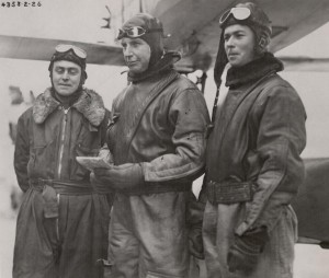 Commander John Rodgers, center, won his Naval wings in 1911. He was a third generation Navy man.