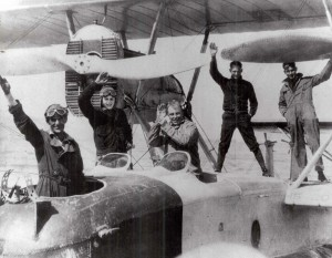 Waving before their departure from San Pablo Bay, John Rodgers (center) and his crew attempted the difficult and dangerous feat of flying over the Pacific Ocean for the first time.