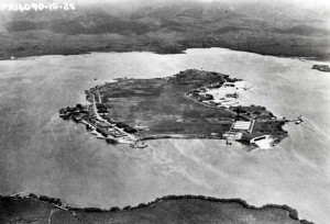 This photo of Ford Island in the middle of Pearl Harbor shows the U.S. Army's Luke Field on the left and the growing Navy facilities on the right side, 1925.