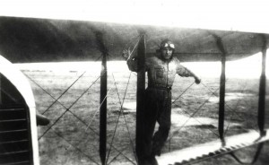 Aviator stands on wings of plane, c1927, Luke Field.