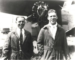 Lts. Albert Hegenberger and Lester Maitland pose in flying togs before the Fokker in which they made the first flight from the Mainland to Hawaii on June 29, 1927. Hegenberger was Chief of the Instrument & Navigation Unit, Materiel Division, Wright Field before the flight.