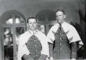 Lts. Hegenberger and Maitland wear the feathered capes of the Hawaii Alii during a ceremony honoring them after their record-setting flight from California to Hawaii on June 29, 1927.