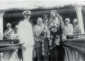 Heaped with lei from well wishers, Lts. Hegenberger and Maitland received a royal send off on July 7, 1929 before boarding the ship that carried them back to the Mainland.