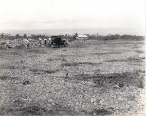 Workers clear rocks off the south end of the Hilo airfield, August 1927.