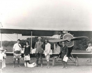 More than 100 people gathered at Spreckelsville, Maui, to witness the arrival of Charles Stoffer (white) and Edward Doney (hand on propeller) with 50 copies of the Sunday Honolulu Advertiser in October 1923. It was the first time Maui residents could read the newspaper on the same day of issue.