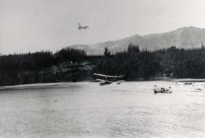 Louis R. Gowans Sr flies his Army plane past Waikiki.