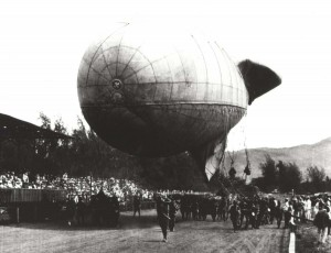 Tethered observation balloon being paraded at Kapiolani Park during 4th of July or Army Day Celebration, c1921-1923.