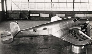 Amelia Earhart's Lockheed Electra plane in a Wheeler Field hangar being tuned for her attempted flight around the world, March 19, 1937.