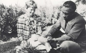 Honolulu Sheriff Duke Kahanamoku shows Amelia Earhart how pineapples are prepared for eating, January 2, 1935 at the Royal Hawaiian Hotel.