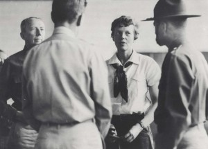 Amelia Earhart talks to Army weather experts at Wheeler Field before taking off for Howland Island on the next leg of her around the world flight, March 20, 1937.
