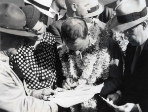 Charles Kingsford Smith signs the customs manifest at Wheeler Field after his arrival from Fiji, October 29, 1934.