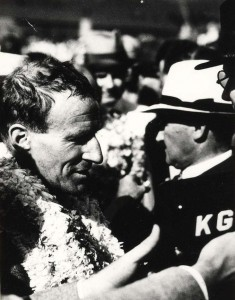 Sir Charles Kingsford Smith at KGU mike is interviewed by the press upon his arrival at Wheeler Field, October 29, 1934.