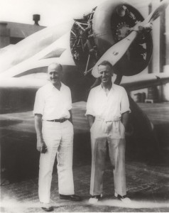 Navigator P.G. Taylor and pilot Sir Charles Kingsford-Smith with their plane, Lady Southern Cross. They were in Honolulu for four days and nights while their aircraft was made ready for flight. They departed Hawaii on November 3, 1934 on the final leg of the first west-east flight across the Pacific.
