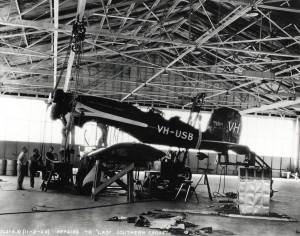 The Lady Southern Cross undergoes repairs at Wheeler Field hangar, November 2, 1934. When Army Air Corps technicians dismantled the fuel system and removed the fuselage tanks, a large crack was found in one tank.