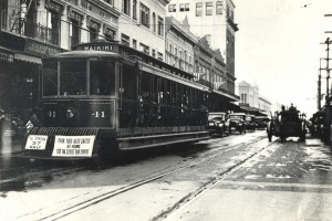 Park your auto safely at home and use the street car service in Downtown Honolulu, 1930s.