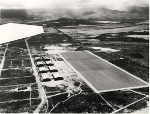 Work was completed on four double hangars, a paved 800 x 3,000-foot landing mat, dock, boathouse and mole, sewer system, fresh water system, radio building, operations building with a fenced magazine area, railroad and parallel highway by July 21, 1937. Navy censors blocked out Pearl Harbor.