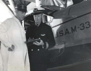 Inter-Island Airways, August 30, 1935. Captain Charles I. Elliott and William Carman, Maintenance Superintendent go over an amphibian plane.