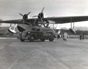 Inter-Island Airways. An amphibian is fueled by a Standard Oil truck before leaving John Rodgers Airport.