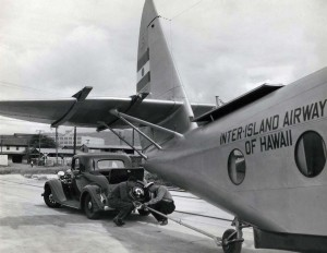 Inter-Island Airways. A Nash is used to tow the world's fastest Sikorsky S-43 amphibian from the dock to John Rodgers Airport after arrival on a freighter at Honolulu Harbor. The eight-mile trip with the nine-ton plane was accomplished with ease.