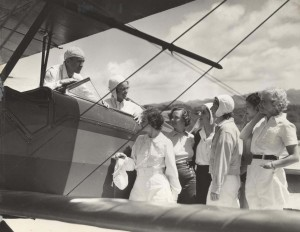 Flying Instructor Olean V. Andrew April 13, 1935. Pilot Andrews, Evelyn Hudson, assistant instructor; Winifred Hudson, Helen Smith, Virginia Thomas, Madeline Hayden, Emma Chung, Clora Curtis.
