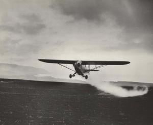 Crop dusting by air, Honolulu, 1930s.